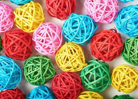 straw twig: Surface covered with the multiple decorative and colored straw balls as an abstract background composition