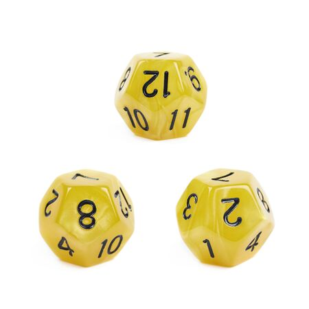 roleplaying: Yellow roleplaying polyhedral dodecahedron gaming plastic dice isolated over the white background, set of three different foreshortenings