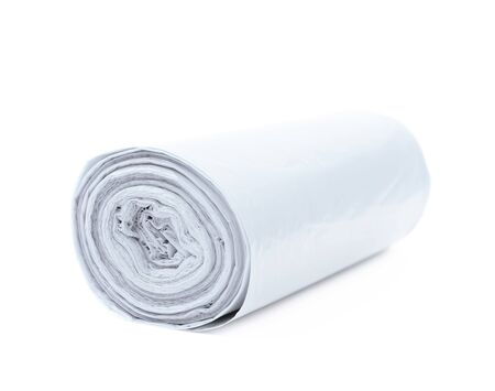 degradable: White plastic polyethylene trash bag roll isolated over the white background Stock Photo