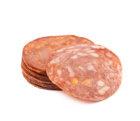 salame: Pile of multiple Italian sausage salame napoli slices isolated over the white background