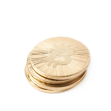 crypto: Pile of golden bitcoin currency tokens isolated over the white background
