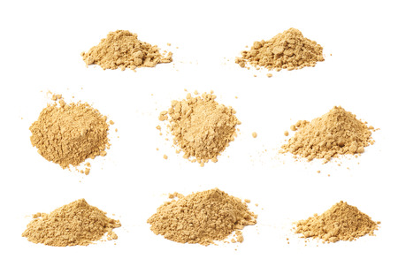 Pile of dry ginger cooking powder isolated over the white background, set of eight different foreshortenings