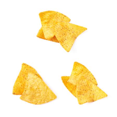 tortilla de maiz: Pila de unos chips de tortilla de maíz aisladas sobre el fondo blanco, conjunto de tres diferentes escorzos Foto de archivo