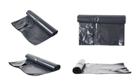 polythene: Roll of black plastic garbage bags isolated over the white background, set of four different foreshortenings