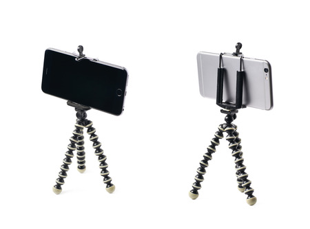 stabilization: Smartphone set up on a tripod isolated over the white background, set of two different foreshortenings