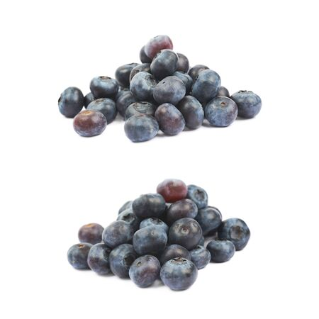 bilberries: Pile of ripe bilberries isolated over the white background, set of two different foreshortening