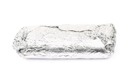 sandwitch: Sub sandwich wrapped in silver metal foil isolated over the white background