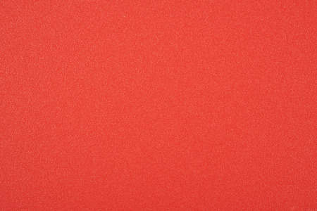plastic texture: Close-up red plastic texture fragment as a backdrop composition Stock Photo