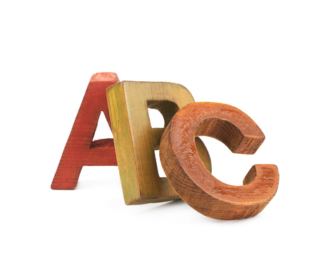 group b: ABC composition made of colored wooden letters isolated over the white background Stock Photo