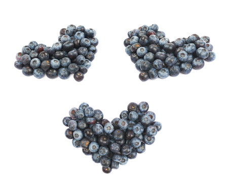 bilberries: Heart shape made of bilberries isolated over the white background, set of three different foreshortenings