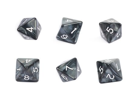 roleplaying: Roleplaying black polyhedral octahedron gaming plastic dice isolated over the white background, set of six different foreshortenings Stock Photo