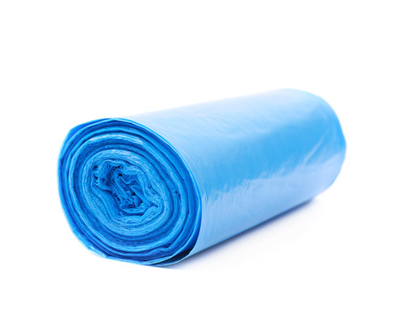 degradable: Blue plastic polyethylene trash bag roll isolated over the white background Stock Photo