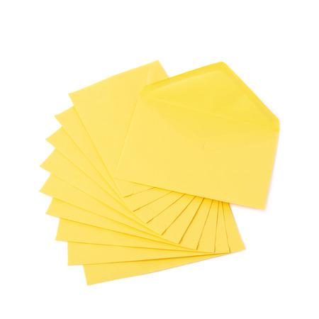 letter envelopes: Stack of multiple yellow letter envelopes isolated over the white background