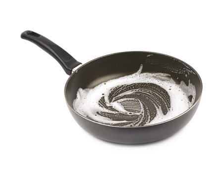lavar platos: Pan covered with the dishwashing liquids foam isolated over the white background