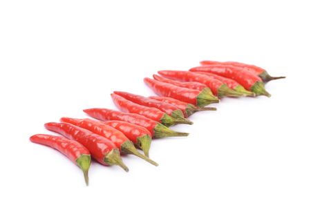 lined up: Lined up pile of red italian peppers isolated over the white background