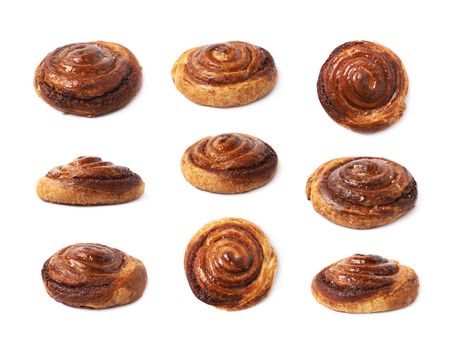 Cinnamon roll pastry bun isolated over the white background, set of nine different foreshortenings Stock Photo