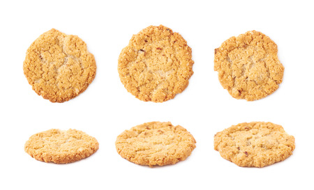 oatmeal cookie: Thin oatmeal cookie isolated over the white background, set of six different foreshortenings Stock Photo