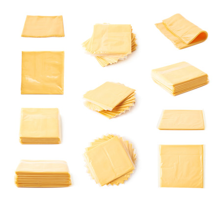 Set of multiple processed cheese slices compositions isolated over the white background, set of multiple different foreshortenings
