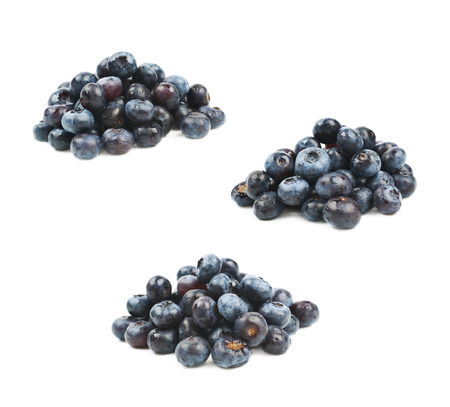 bilberries: Pile of ripe bilberries isolated over the white background, set of three different foreshortenings