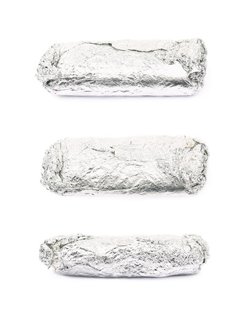 sandwitch: Sub sandwich wrapped in silver metal foil isolated over the white background, set of three different foreshortenings Stock Photo