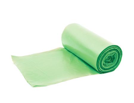 Green plastic polyethylene trash bag roll isolated over the white background