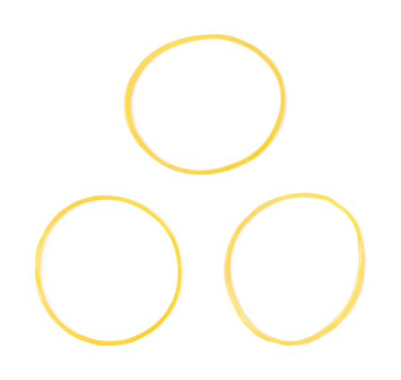 rubberband: Office yellow rubber band isolated over the white background, set of three different foreshortenings Stock Photo
