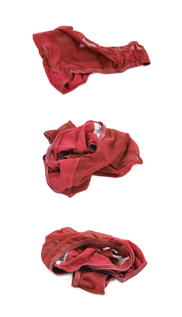 fetish wear: Crumpled red female panties isolated over the white background, set of three different foreshortenings