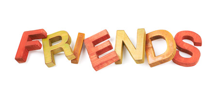 Word Friends made of colored with paint wooden letters, composition isolated over the white background Stock Photo