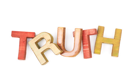 axiom: Word Truth made of colored with paint wooden letters, composition isolated over the white background