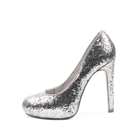 Shining silver high-heeled footwear shoe isolated over the white background Stock Photo