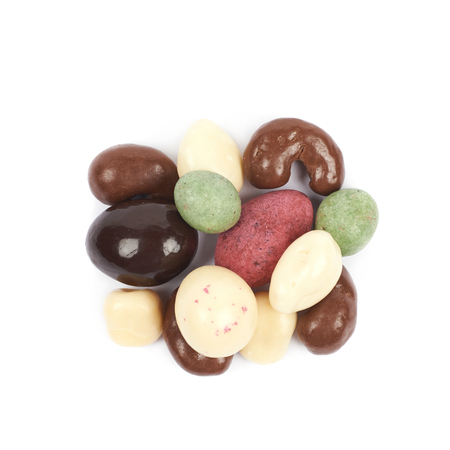 differently: Pile of multiple differently glazed chocolate nuts isolated over the white background