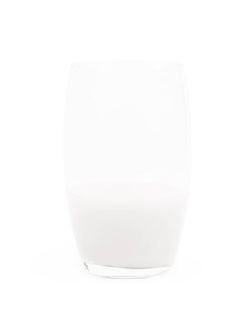 pasteurized: Tall glass half-filled with milk isolated over the white background Stock Photo