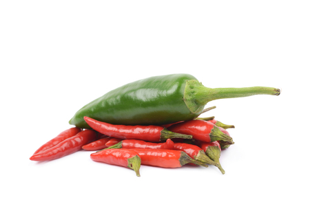 red jalapeno: Pile of red italian peppers with a green jalapeno over it, composition isolated over the white background