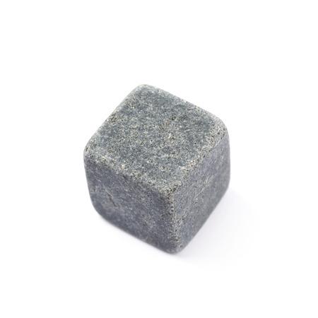 Single whiskey stone cube isolated over the white background