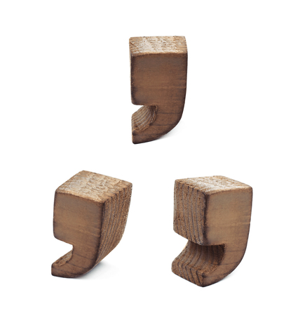 sawn: Comma symbol sawn of wood and paint coated, set of three different foreshortenings
