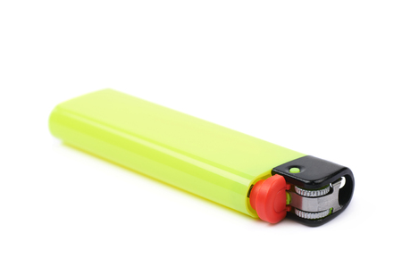 Bright yellow plastic lighter lying on its side, isolated over the white background