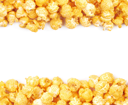 Copyspace background composition with the borders made of cheese flavored orange popcorn flakes isolated over the white background Stock Photo
