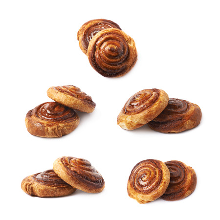 Two cinnamon roll pastry buns, composition isolated over the white background, set of five different foreshortenings Stock Photo