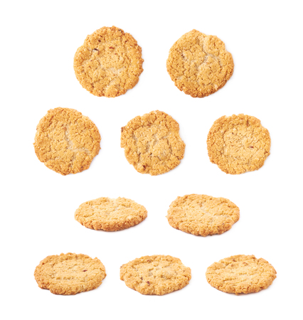oatmeal cookie: Thin oatmeal cookie isolated over the white background, set of multiple different foreshortenings Stock Photo