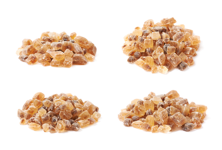 Pile of brown rock sugar crystals isolated over the white background, set of four different foreshortenings Stock Photo