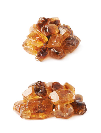 rock pile: Pile of brown rock sugar crystals isolated over the white background, set of two different foreshortenings