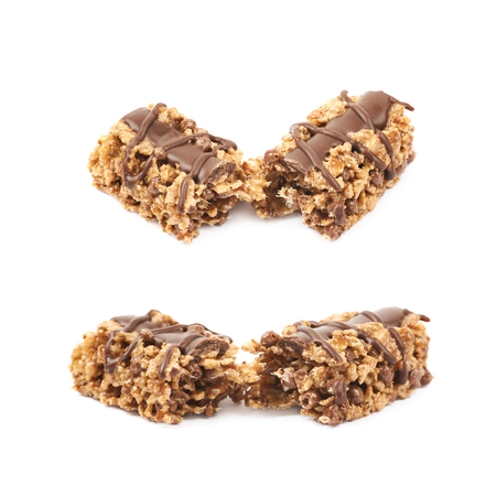 chewy: Broken in two parts chocolate nutrient chewy grains bar isolated over the white background, set of two foreshortenings