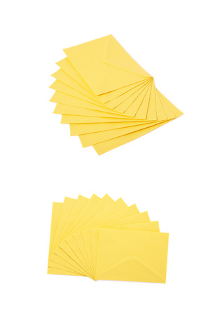 letter envelopes: Stack of multiple yellow letter envelopes isolated over the white background, set of two different foreshortenings Stock Photo