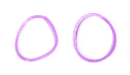Single rubber loom band isolated over the white background, set of two different foreshortenings Stock Photo