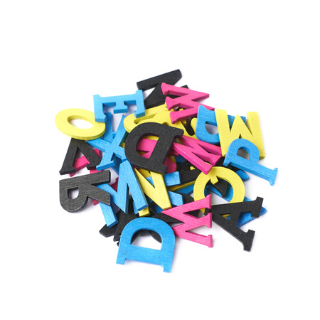 Pile of cmyk painted wooden letters isolated over the white background Stock Photo