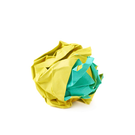dirty sheet: Colorful crumbled paper ball isolated over the white background