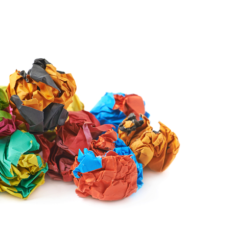 dirty sheet: Pile of colorful crumbled paper balls, composition isolated over the white background