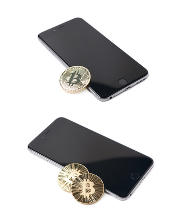 token: Golden bitcoin currency token over the surface of the mobile smart phone, composition isolated over the white background, set of two different foreshortenings