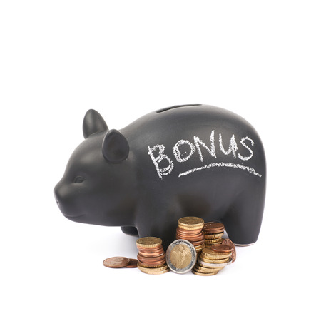 Word Bonus written with chalk on a black ceramic piggy bank coin container next to a pile of euro coins, composition isolated over the white background Stock Photo