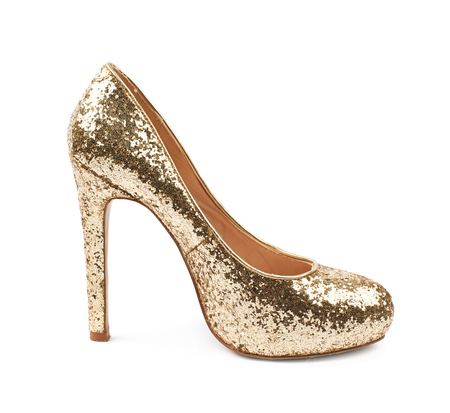 Shining golden high-heeled footwear shoe isolated over the white background Stock Photo